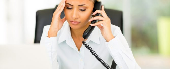 Worried woman talking to IRS debt collector