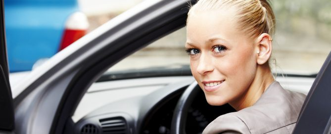 Smiling woman after obtaining cheaper car insurance