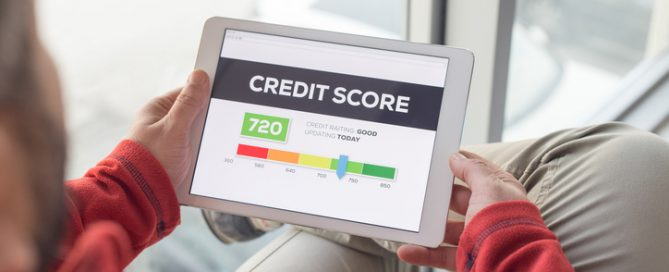 Man looking at credit score in tablet